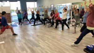 A class at STINKYBODY doing yoga